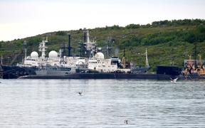 A picture taken on July 2, 2019, shows an unidentified submarine in the city of Severomorsk, in Russia. - Fourteen Russian seamen have died in a fire on a deep-water research submersible, Russia's defence ministry said on July 2, 2019.