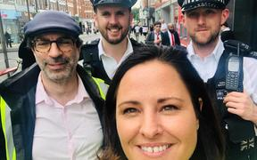 Rotorua woman Emma Rigby with police in Enfield, London, where she runs an online platform called Love Your Doorstep and a community patrol scheme.