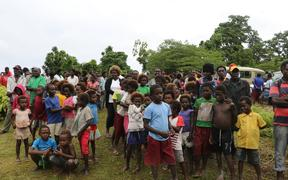 A crowd of people in Bougainville watching the handover of the agreed definitions for the two questions for the Independence Referendum. The first Greater Autonomy for Bougainville and the other full Independence from Papua New Guinea.
