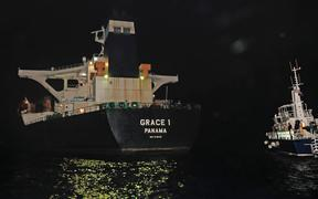 A handout picture released by the Ministry of Defence shows the Panama registered Grace 1 tanker halted by Gibraltar police and a detachment of UK soldiers