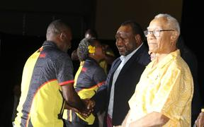 PM James Marape (c) and PNG Olympic Committee President Sir John Dawanicura (R) with athletes at the Team PNG farewell ceremony.