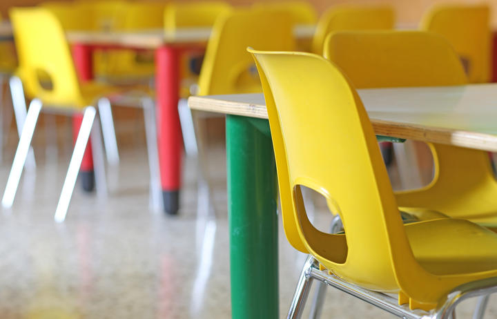 A file photo shows bright yellow chairs in a kindergarten or pre-school.