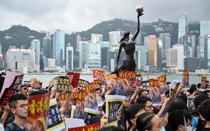 Protesters gather to take part in a march to the West Kowloon railway station, where high-speed trains depart for the Chinese mainland, during a demonstration against a proposed extradition bill in Hong Kong on July 7, 2019.