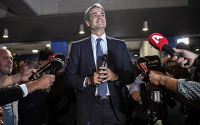 Greece's newly elected Prime Minister and leader of conservative New Democracy party Kyriakos Mitsotakis, speaks to the press outside the party's headquarters after the official results of the elections, in Athens on 7 July, 2019.