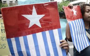 "Protesters display the West Papuan pro-independence ""Morning Star"" flag during a demonstration by mostly university students from Free Papua Organization and the Papua Student Alliance in Jakarta on April 3, 2017. -"