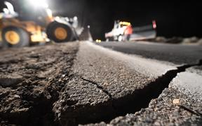 Highway workers repair a hole that opened in the road as a result of the July 5, 2019 earthquake, in Ridgecrest, California, about 150 miles (241km) north of Los Angeles,