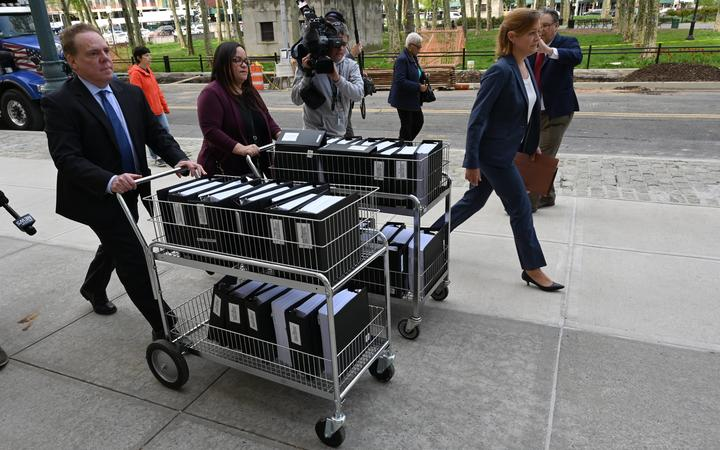 Members of the prosecution in the Nxivm case arrive with documents at Brooklyn Federal Court on May 7, 2019.