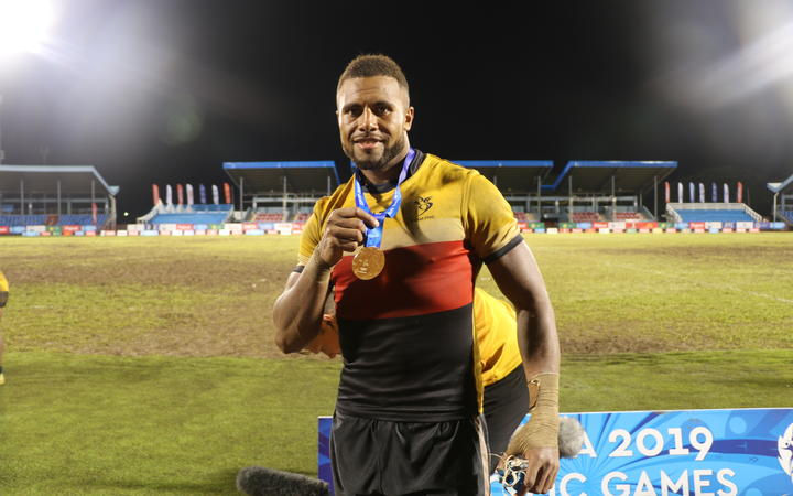 Fiji men's captain Luke Nadurutalo (in a PNG shirt)