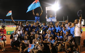 Fiji league teams celebrating their gold medals.