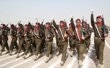 Iraqi Army soldiers march during the graduation ceremony of the Iraqi Army's Non- Commissioned Officers' Academy Junior Leaders Course at Taji Military Complex, Iraq.