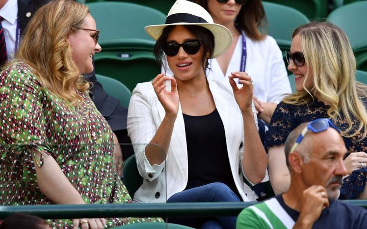The Duchess of Sussex watches US player Serena Williams playing against Slovakia's Kaja Juvan during their women's singles second round match.