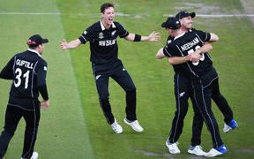 Matt Henry celebrates the dismissal of Karthik and Neesham's catch during the Black Caps semifinal win over India at Old Trafford.