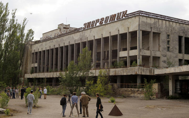 Visitors look in the abandoned city of Pripyat, near the Chernobyl nuclear power plant, Ukraine, on 7 June 2019.