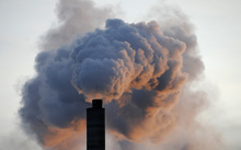 In a file picture taken on 2 January 2009, heavy smoke billows from the chimney of the Kraft paper factory in Pietarsaari, Finland.