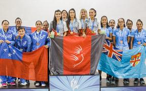 New Caledonia win gold in squash