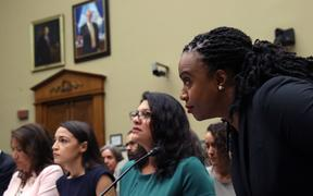 Rashida Tlaib (centre), who responded by calling Trump 'a lawless and complete failure of a president', with Alexandria Ocasio-Cortez (left) and Ayanna Pressley (right).