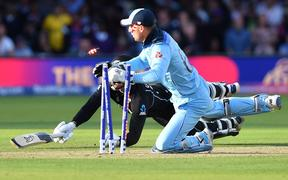 England's Jos Buttler runs out New Zealand's Martin Guptill to win the super-over to win the 2019 Cricket World Cup final.