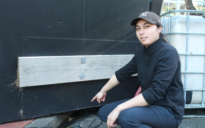 Sushi Bi worker Wini Morris shows where the penguins made their shelter.