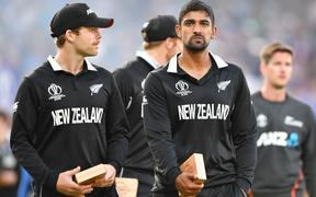New Zealand's Lockie Ferguson (L) and New Zealand's Ish Sodhi (R) react to their defeat after the 2019 Cricket World Cup final between England and New Zealand at Lord's