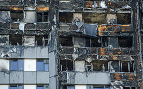 Close up view of the exterior of the Grenfell Tower block of flats in which at least 80 people lost their lives in a fire. In the Australian state of Victoria $600m is being used to fund remedial work.