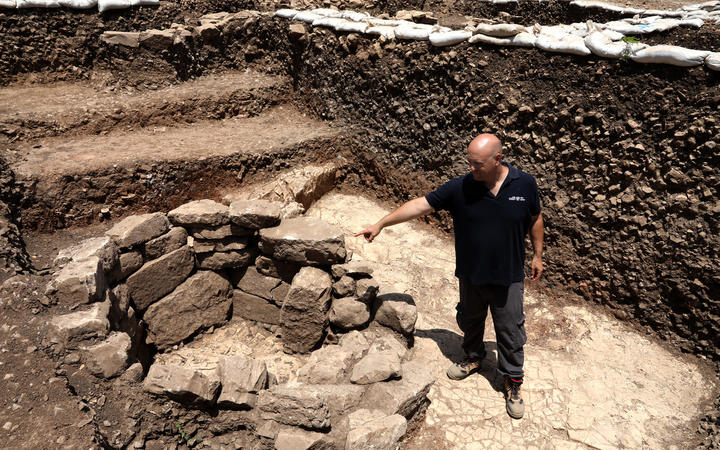 Archeologist of the Israel Antiquities Authority Jacob Vardi is pictured at the site of a settlement from the Neolithic Period (New Stone Age), discovered during archaeological excavations.