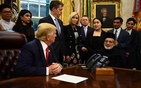 US President Donald Trump meets with survivors of religious persecution (Farid Ahmed, sitting right).
