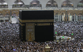 Muslims gather around the Kaaba, Islam's holiest shrine, at the Grand Mosque in the Saudi city of Mecca.