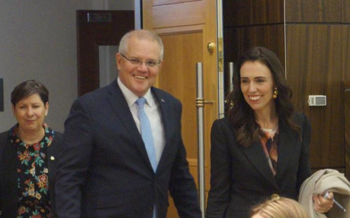 Australian Prime Minister Scott Morrison with New Zealand Prime Minister Jacinda Ardern head into a meeting in July, 2019.
