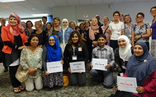 Members of New Zealand's Syrian community gather to welcome new refugee arrivals to Wellington on 26 February 2016.