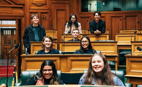 Molly Doyle (front right) is the Youth MP for Green Party co-leader and Minister of Climate Change James Shaw. Doyle is surrounded by the other Youth MPs representing the Green Party including Luke Wijohn (far right back).