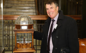 Historian Ian McGibbon with the Versailles Pen in its special wood and leadlighted glass display stand.