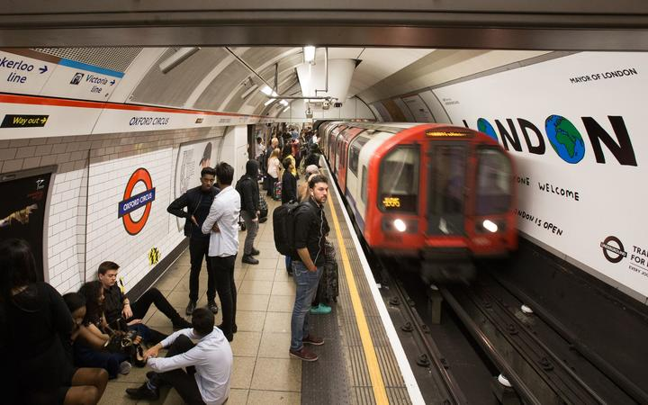 A London Underground train arrives at Oxford Circus station in central London on August 20, 2016, following the launch of the 24 hour night tube service. - The Night Tube