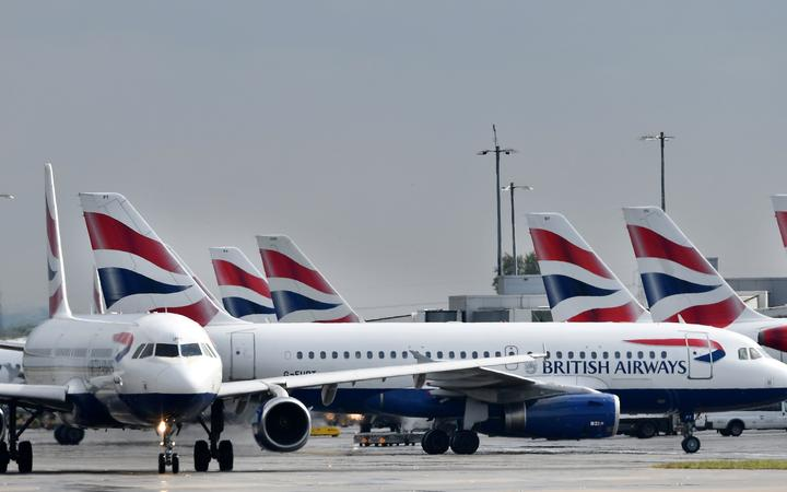 British Airways passenger aircraft are pictured at London Heathrow Airport, west of London on May 3, 2019. -