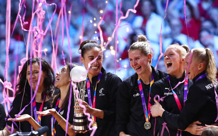 Maria Folau holds the World Championship Trophy as the team celebrate winning the Netball World Cup with a 52-51 victory over Australia in the final.