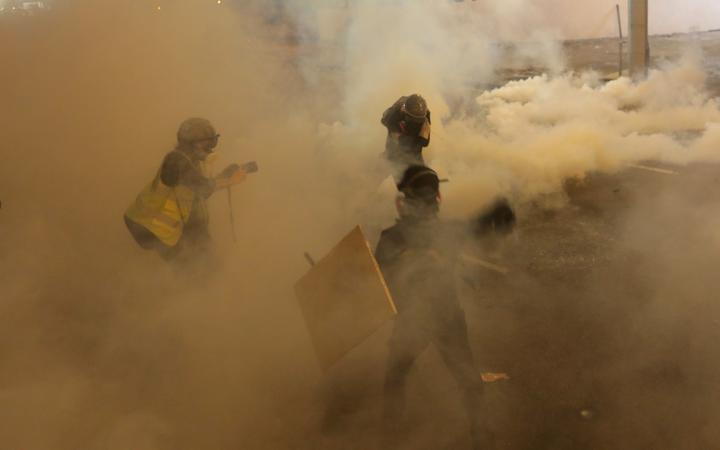 Hong Kong protests: Police fire tear gas at demonstrators
