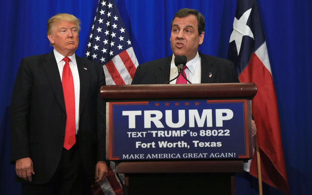 A file photo shows Donald Trump, right, and Chris Christie during a break in the Republican Presidential Candidates' Debate in Manchester, New Hampshire, on 6 February 2016.