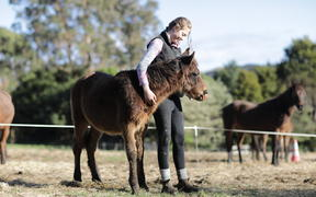 Clara Haines and a Kaimanwa foal from the 2019 muster