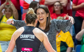 Silver Ferns coach Noeline Taurua celebrates with Gina Crampton after the semi-final victory over England.