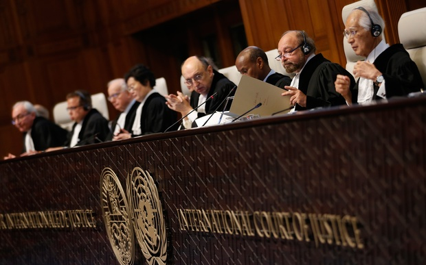 International Court of Justice president Ronny Abraham, second right, examines a document during a court case in December 2015.