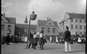 Girls playing basketball - with a basket! – in Auckland c. 1910