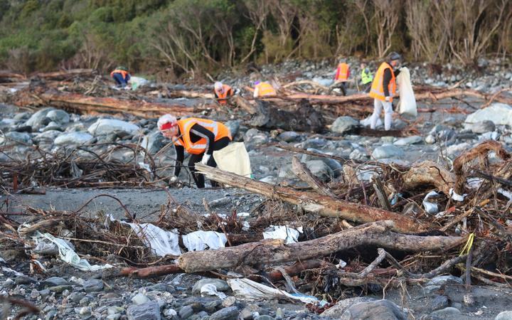 Volunteers pick up rubbish where a disused Fox River landfill spilled litter on the West Coast.