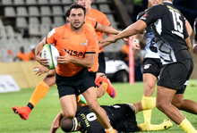 Argentina's Rodrigo Baez of the Jaguares (L) of the Jaguars breaks through during their Super Rugby match against South Africa's Cheetahs on February 26, 2016 in Bloemfontein, South Africa.