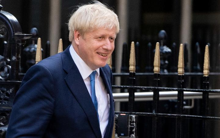 New Conservative Party leader and incoming prime minister Boris Johnson leaves the Conservative party headquarters in central London.