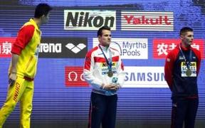 Chinese swimmer Sun Yang has words with Briton Duncan Scott after extraordinary scenes following the 200m freestyle final at the world champs in Gwangju.
