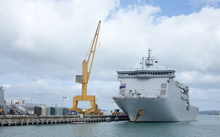 HMNZS Canterbury is being loaded at Devonport Naval base before heading to Fiji.