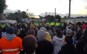 Protesters and police at Ihumatao.