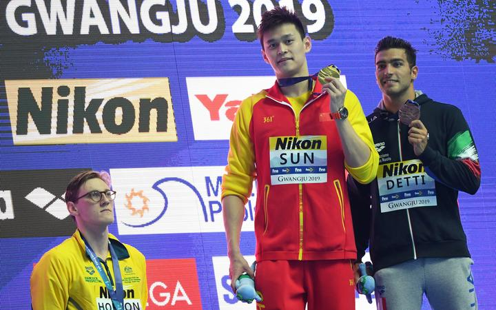Silver medallist Australia's Mack Horton (left) refuses to stand on the podium with gold medallist China's Sun Yang (centre) and bronze medallist Italy's Gabriele Detti after the final of the men's 400m freestyle at the 2019 World Championships in South Korea.