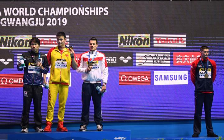 (From left) silver medallist Katsuhiro Matsumoto, gold medallist Sun Yang and tie bronze medallist Martin Malyutin pose as tie bronze medallist Duncan Scott stands aside after the final of the men's 200m freestyle at the 2019 World Championships in South Korea.