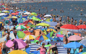 People crowd the beach at Zinnowitz on the island of Usedom in the Baltic Sea, northern Germany.