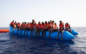 An overloaded rubber boat in international waters off the Libyan coast earlier this month.